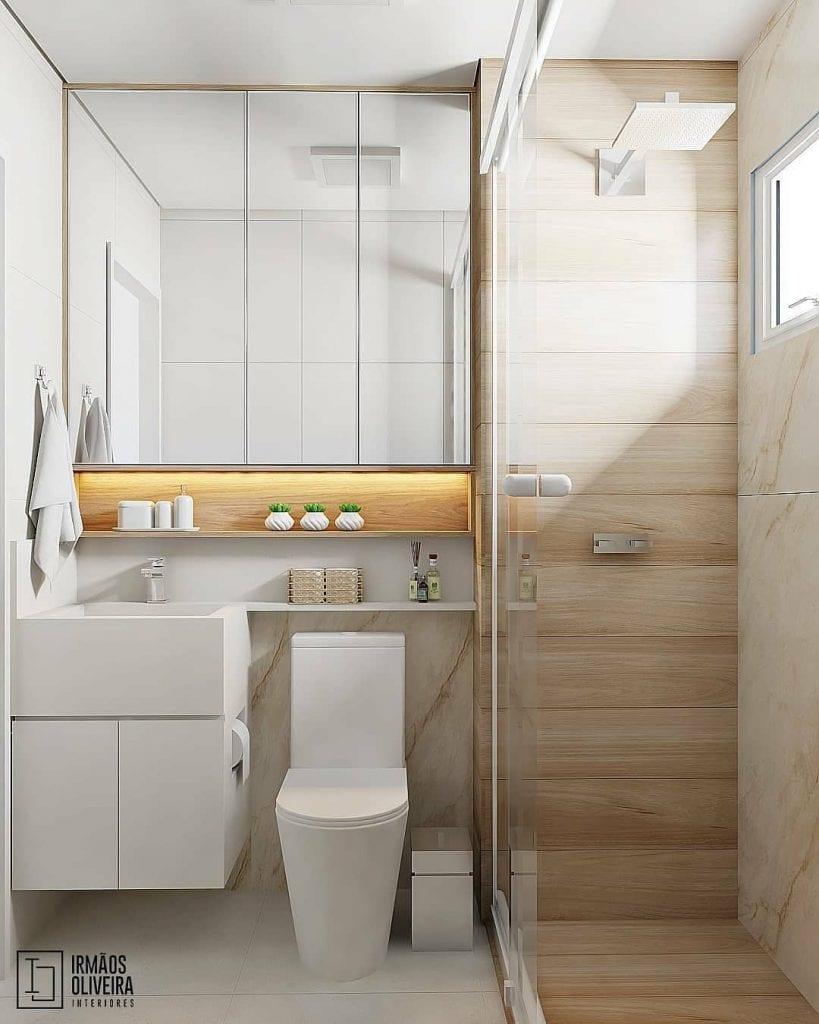 projeto de banheiro pequeno em tons claros e madeira