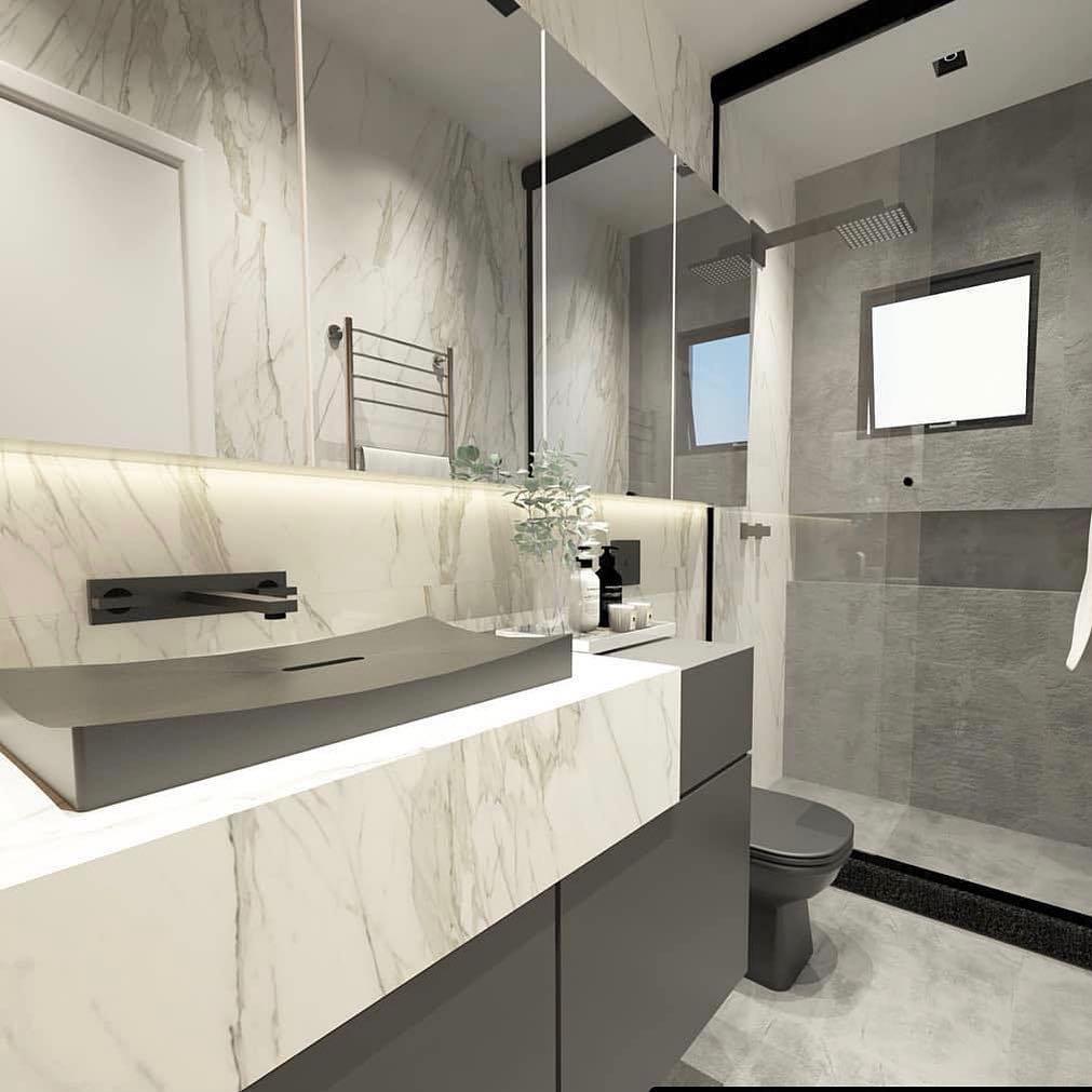 banheiro moderno em tons de cinza e revestimento que imita mármore