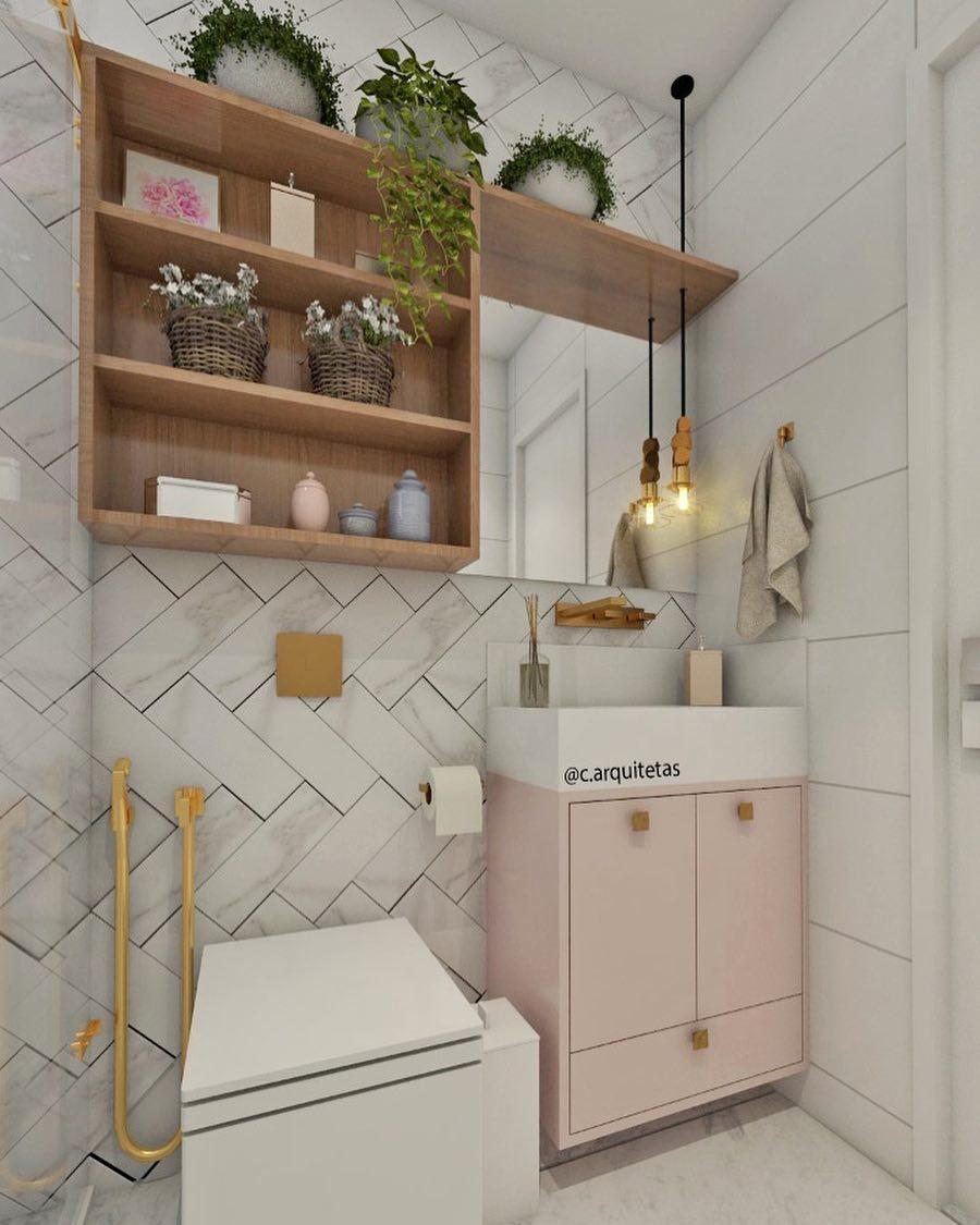 banheiro branco com armario rosa claro