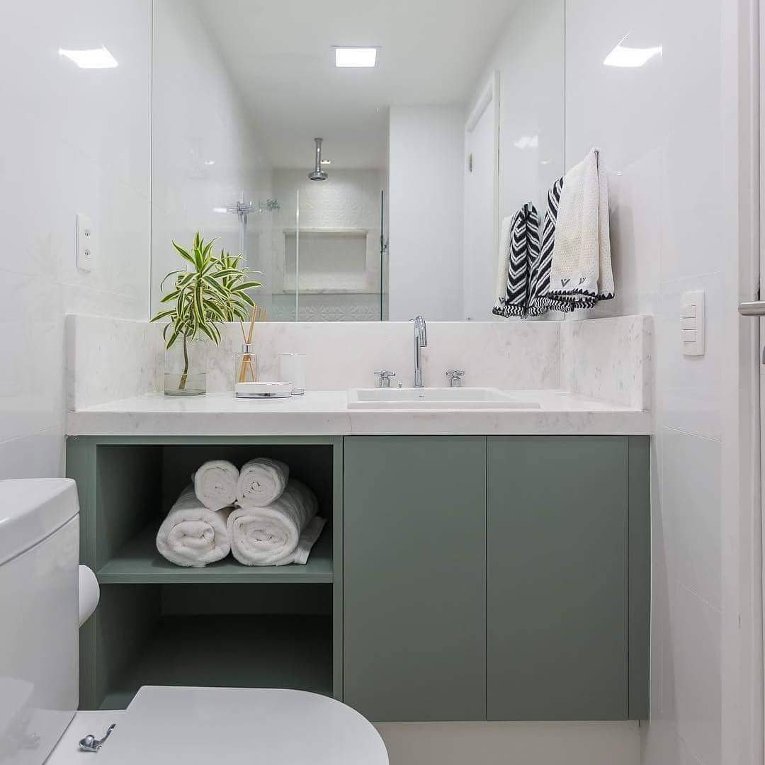 banheiro com movel verde