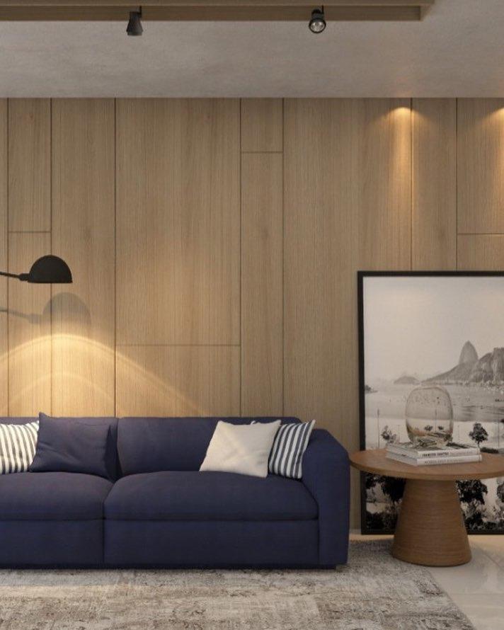 sofa azul e madeira clara