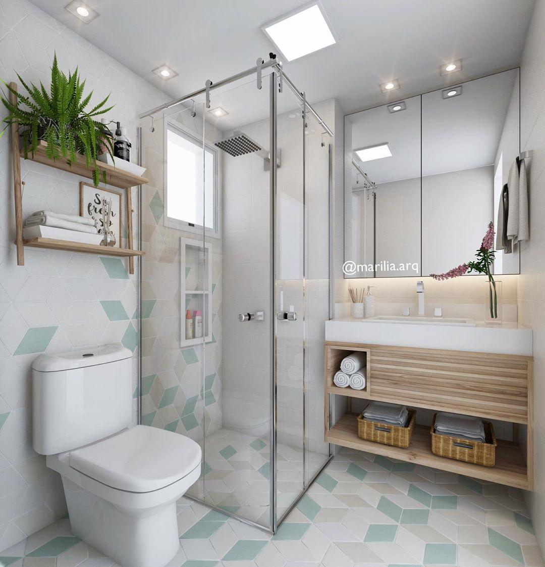 banheiro branco com toques de verde claro