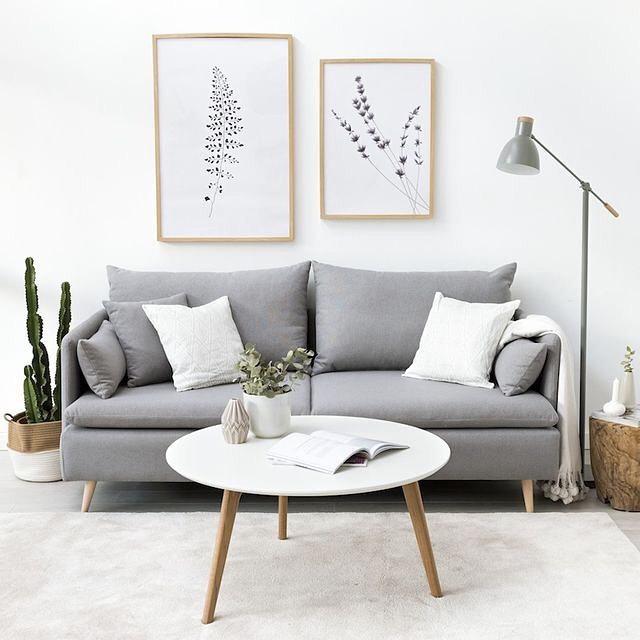ambiente neutro e clean com sofa cinza moderno