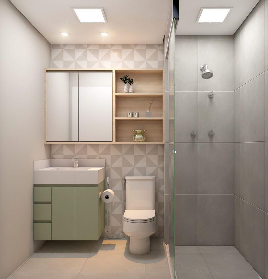 banheiro com armario verde e cinza