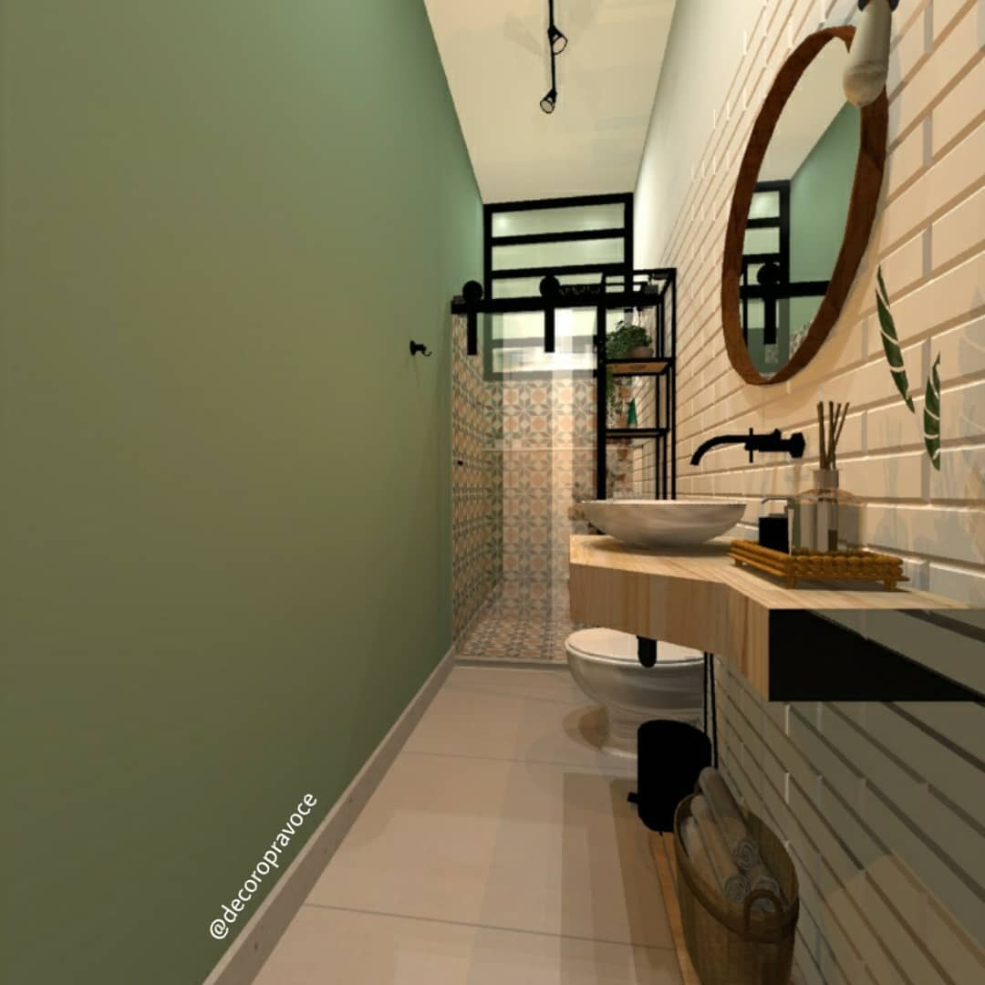 banheiro com parede pintada verde