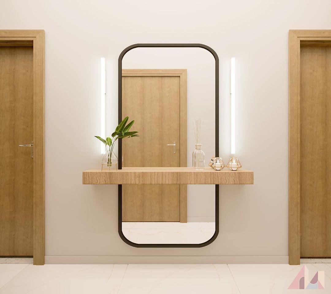 corredor com espelho e aparador