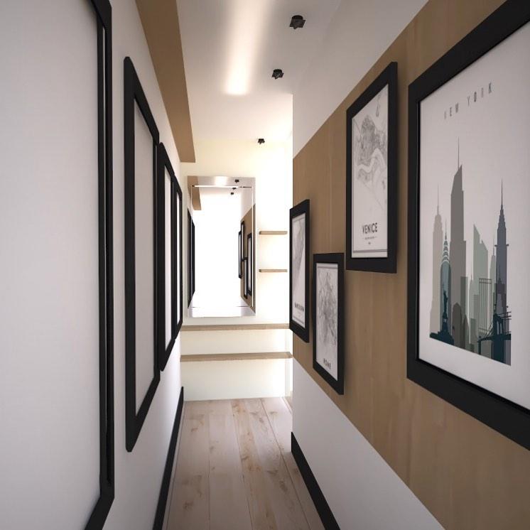 corredor decorado com papel de parede e quadros