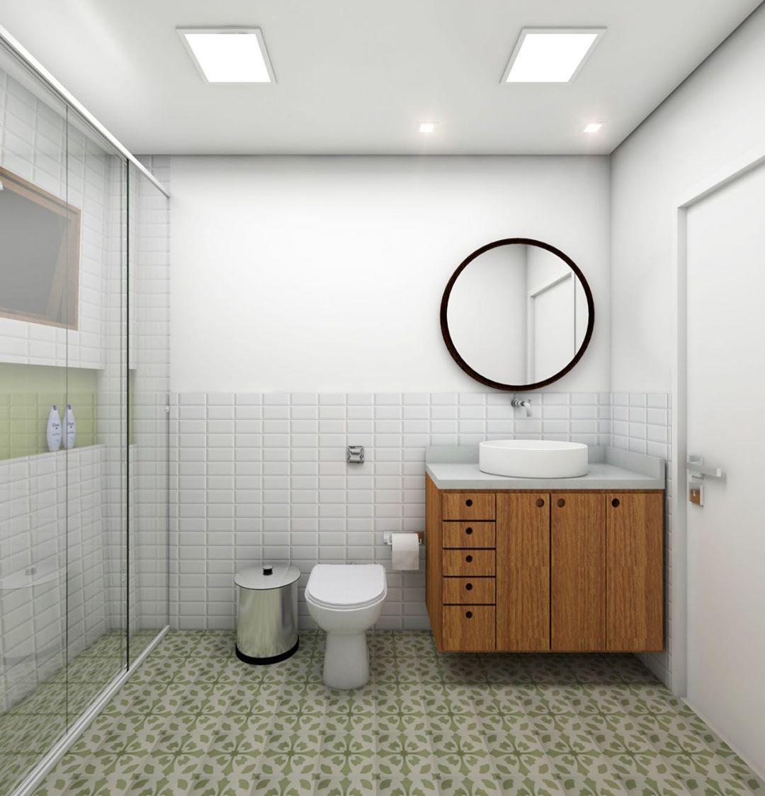 banheiro com piso verde