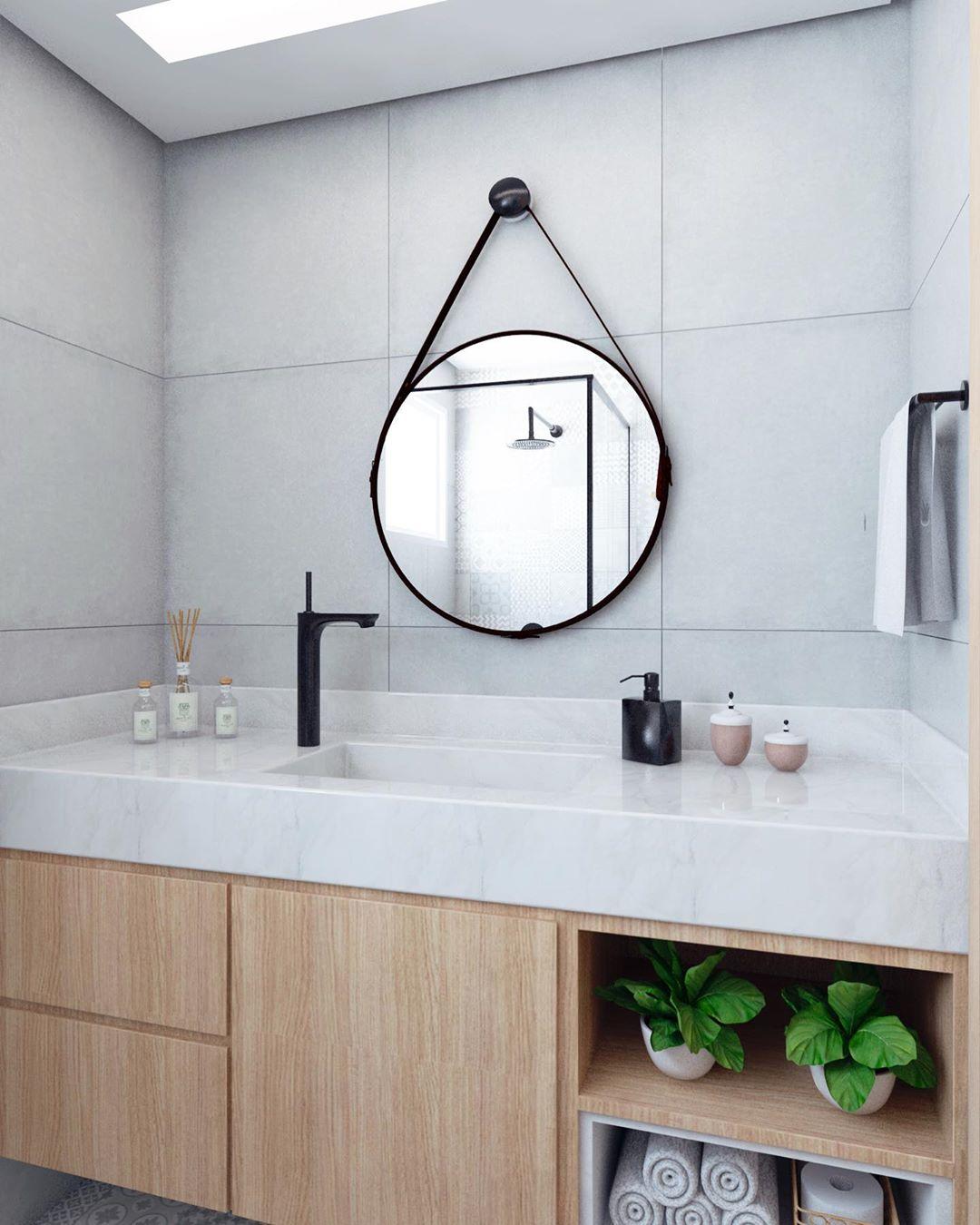 banheiro com espelho redondo adnet