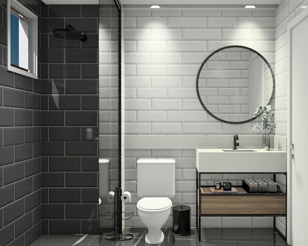espelho redondo no banheiro preto e branco