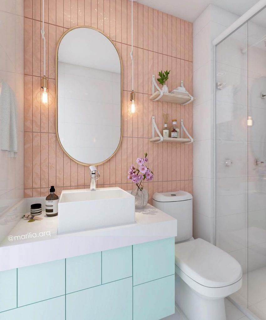 armario de banheiro em tom verde claro em banheiro com parede rosa