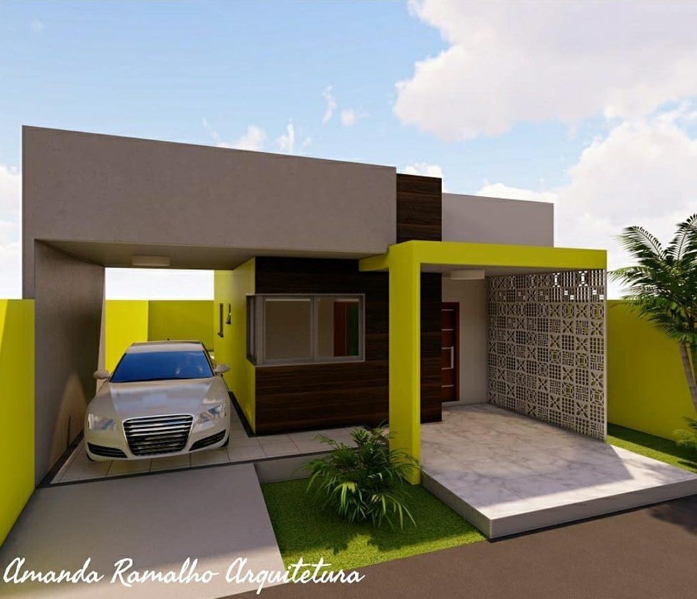 fachada de casa popular com cobogo e cores vibrantes