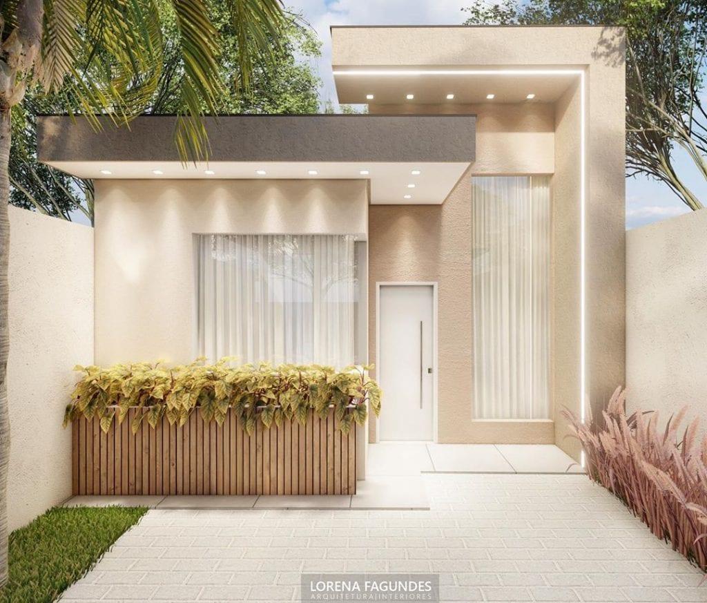fachada de casa popular elegante em cores neutras e iluminação