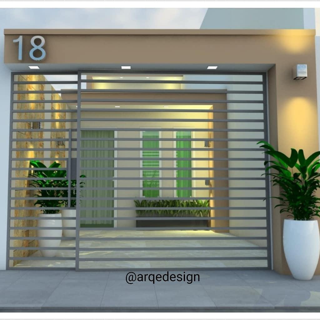 fachada de casa popular com modelo de portão vazado
